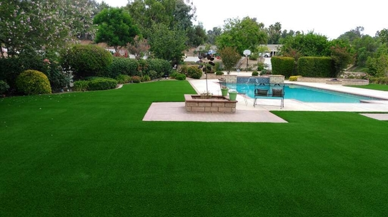 Back yard completely covered with artificial grass next to a swimming pool, Whittier CA