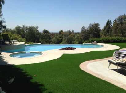 A photo of synthetic grass surrounding a wooded back yard with a pool and jacuzzi, Whittier CA