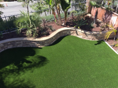 Aerial view of artificial grass bordered by a pony wall