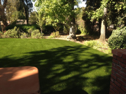 Artificial lawn installed next to trees and a planter, Whittier CA