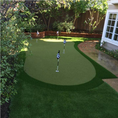 Artificial putting green with four flags in a back yard, Whittier CA
