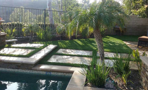 A photo of intricately cut artificial grass in a multi level pool deck, Whittier CA