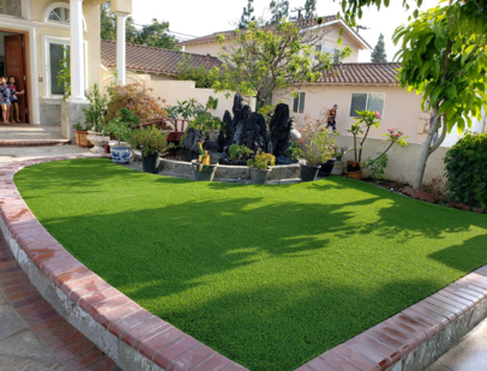 A photo of a raised artificial turf feature with bull nose brick border, Whittier CA