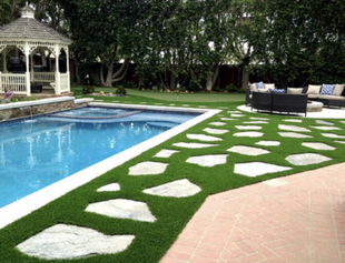 Photo of artificial lawn with stepping stones next to a pool and gazebo, Whittier CA