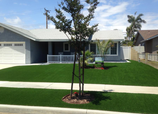 Photo of front yard artificial lawn installed in front of a blue house, Whittier CA