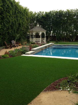 A photo of a gazebo and pool with synthetic turf installed around both, Whittier CA