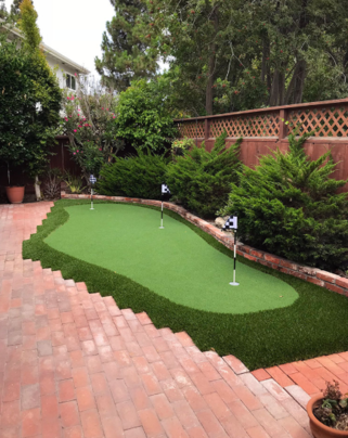 Synthetic putting green in a back yard next to paving stones, Whittier CA